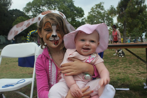 The tongue on my niece's doggie face paint cracks me up!